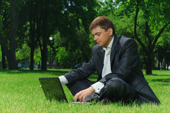 Businessman in the park Stock Images
