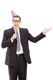Businessman with party hat speaking on microphone Royalty Free Stock Photos