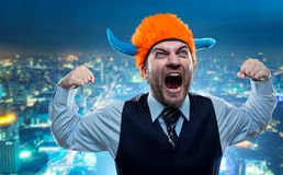 Businessman in party helmet shouting Stock Image
