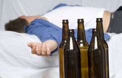 Businessman passed out on the couch. Empty beer bottles Stock Photos