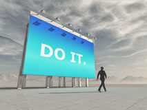 Businessman passes a billboard. With the message DO IT. This is a 3d render illustration Royalty Free Stock Image