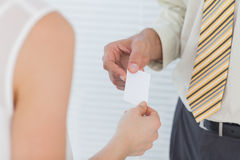 Businessman passing his business card Stock Photo