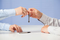 Businessman passing keys to his partner Stock Images