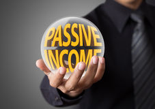 Businessman with passive income concept Royalty Free Stock Photo