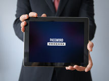 Businessman with password  on a tablet Royalty Free Stock Photography