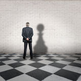 Businessman with pawn shadow Royalty Free Stock Image
