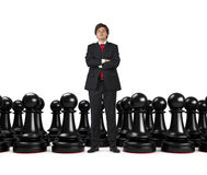 Businessman and pawns Royalty Free Stock Photography