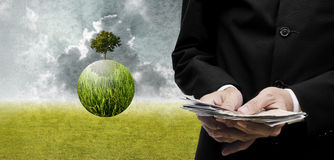 Businessman pay for green business, Sustainable concept Royalty Free Stock Image