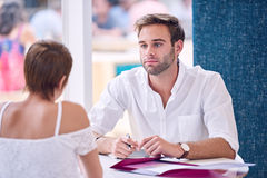 Businessman paying attention to his female partner during business meeting Stock Photos