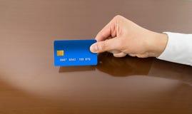 Businessman paying with credit card Stock Photos
