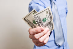 Businessman paying in dollars Stock Photo