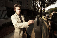 Businessman paying the meter Royalty Free Stock Photography
