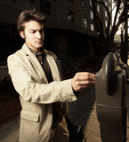 Businessman paying the meter Royalty Free Stock Photo