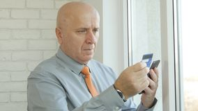 Businessman Paying Online Shopping with Credit Card Using Smartphone royalty free stock photos