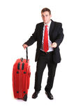 Businessman paying for travel Stock Image