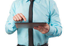 Businessman and PC tablet Stock Photography