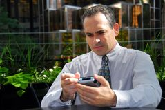 Businessman pda Stock Images