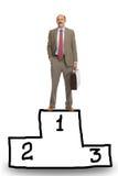 Businessman on a pedestal Stock Photos
