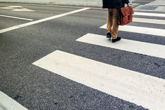 Businessman on pedestrian zebra crossing on his way to work Stock Images
