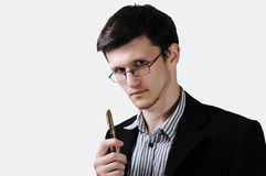 Businessman with pen. Businessman thinking of signing a contract Stock Photo