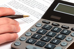 Businessman pen and calculator   Royalty Free Stock Photography