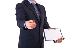 Businessman with pen and clipboard. Stock Photography