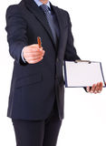 Businessman with pen and clipboard. Stock Photo