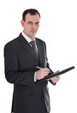 Businessman with pen and notepad Stock Image