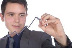 Businessman with pen paints forecast Stock Photos