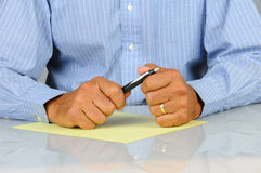 Businessman with pen and paper Royalty Free Stock Photography