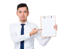 Businessman pen point to clipboard Stock Photography