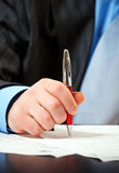 Businessman with pen signing contract. This is close-up of businessman with pen signing contract royalty free stock photos