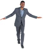 Businessman performing a balancing act Royalty Free Stock Image