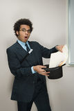Businessman performing magic tricks Stock Photos
