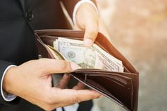 Businessman Person holding an wallet stock image
