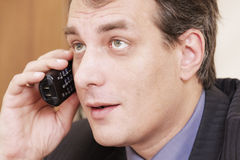 Businessman on phone. Closeup portrait of businessman in formal wear with phone in hand Royalty Free Stock Photos