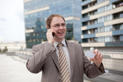 Businessman on the phone. Young businessman on the phone outdoor the office Stock Photo
