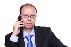 Businessman with phone. Is talking Royalty Free Stock Images