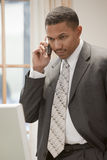 Businessman on the phone. African American businessman on the phone standing in his office Stock Photo