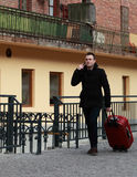 Businessman on the phone. Young businessman on the phone waling in a small cobbled street in a city Stock Photos