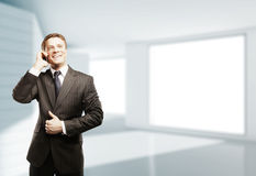 Businessman with phone Royalty Free Stock Photos