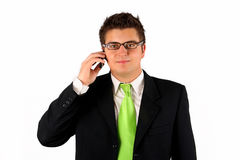 Businessman with phone. Handsome young man in suit on the phone Royalty Free Stock Image