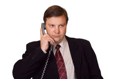 Businessman with phone. Isolated on white background royalty free stock images