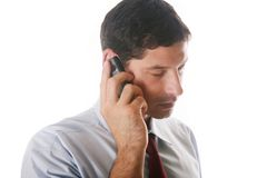 Businessman on the phone. Young businessman speaking on the phone royalty free stock photography