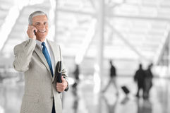 Businessman On Phone in Airport Stock Images
