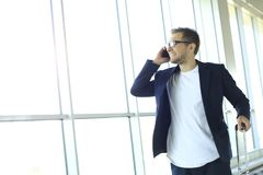 Businessman on the phone at the airport royalty free stock images