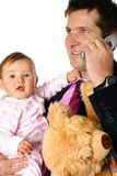 Businessman on phone with baby Stock Photography