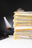 Businessman on Phone Behind Stack of Files Stock Photography