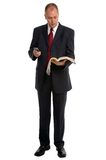 Businessman with Phone book. Businessman dialing a number from the phone book Royalty Free Stock Image