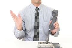 Businessman with a phone. Businessman showing something on the palm of his hand royalty free stock photos